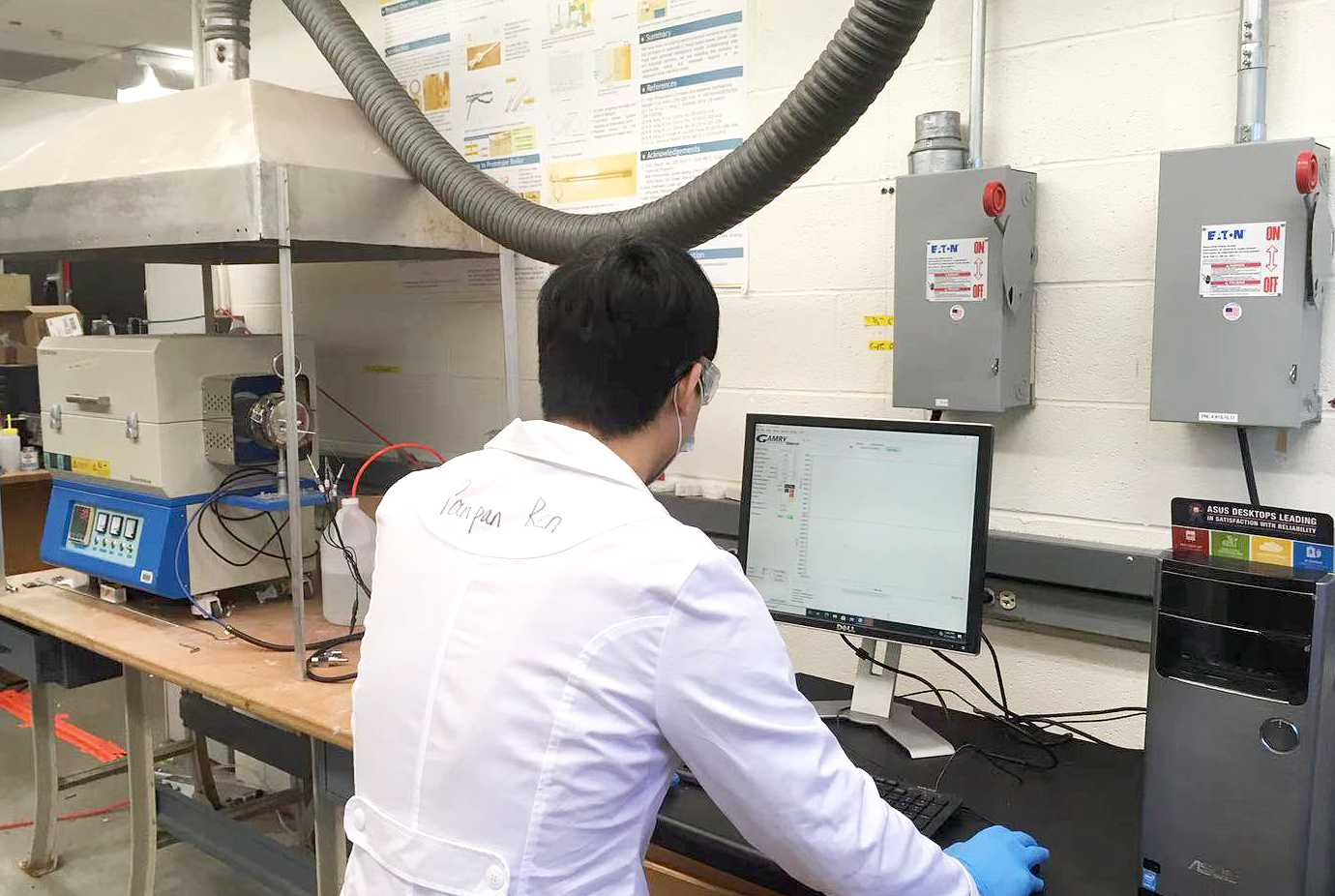 Shanshan Hu, a postdoctoral scholar, performs a high temperature corrosion measurement of alloys. (Submitted Photo)