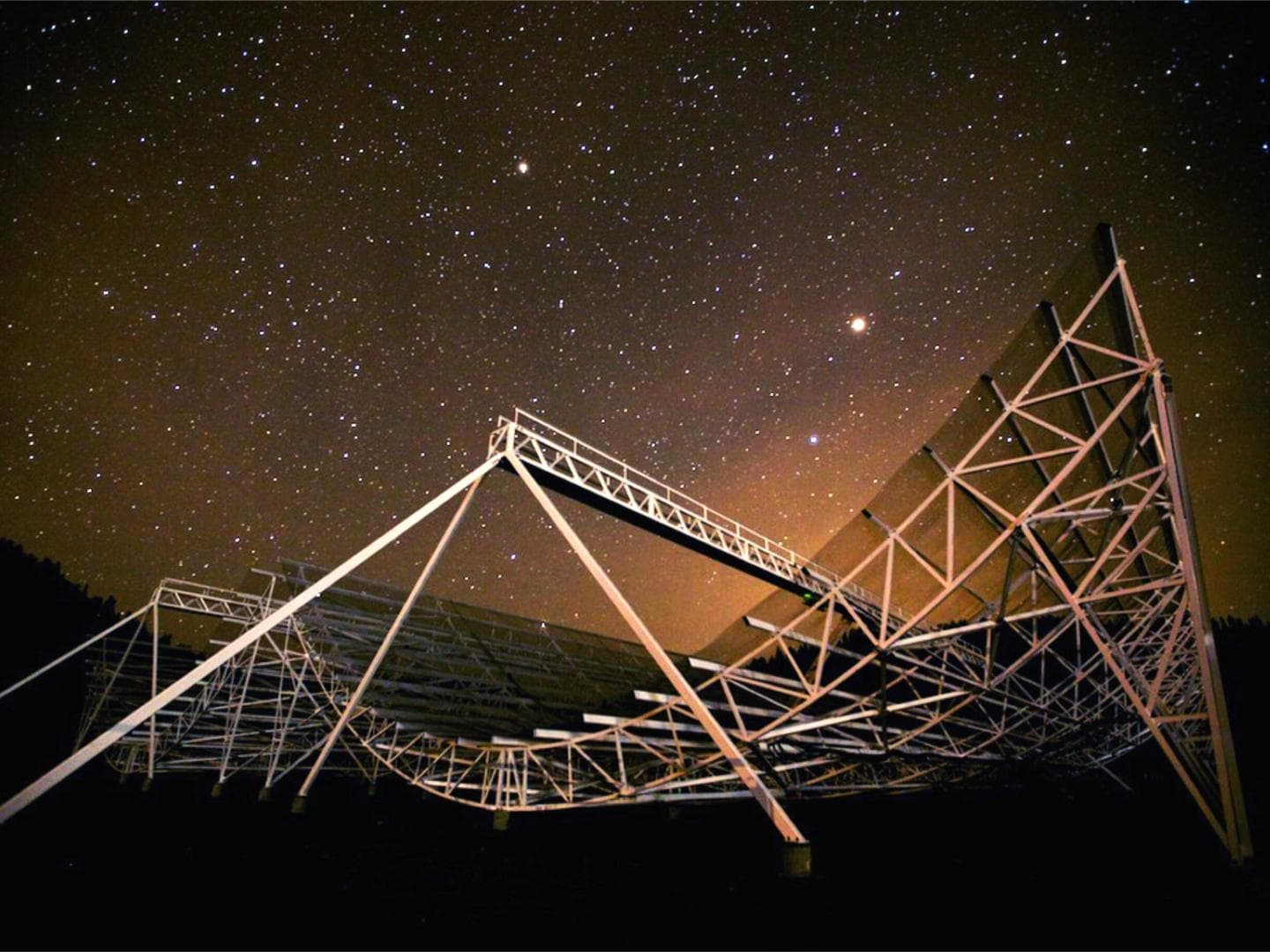 <p>Kevin Bandura, assistant professor of computer science and electrical engineering, will use the Canadian Hydrogen Intensity Mapping Experiment (CHIME) to study the expansion of the universe. (Photo courtesy CHIME/Andre Recnik)</p>